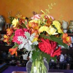 Alstromeria, dusty miller, fragrant sage, roses, and mums come together for this fall arrangement