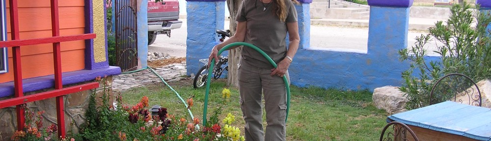 Kate watering her snapdragons