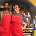 Noble and Alaine model new aprons in our hand built kitchen