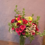 Using antique seed, Kate gorws old-fashioned flowers such as those in this bouquet: hollyhock, amni, and fresia brust in this bright fragrant spring bouquet that brings back memories of youth!