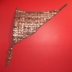 """Run for Cover"" by Kate Thayer. Woven metal, ribbon, paper, fabric, suede over oak branch"