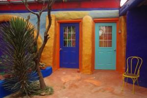 The dark blue door on the left is the Sapphire Room