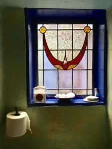 Another stunning stained glass window in the bathroom