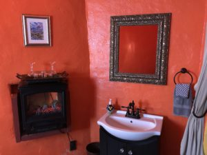 Hand sink and faux fireplace in 2nd room