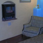 The arches in the cieling of the Turquoise Room are replicated in the arch around the romantic fireplace heater